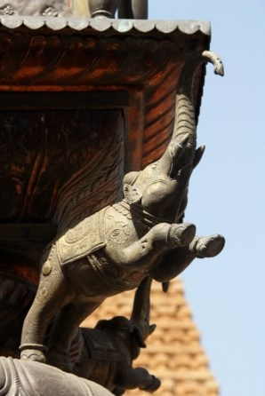 Jumping elephant sculpture