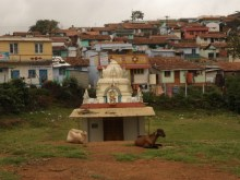 Small Hindu shrine with goats