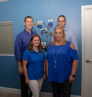 Andrew Dahle, Tyler Moss, Deanna Koppel and Gail Stout Assisting Hands National Office.
