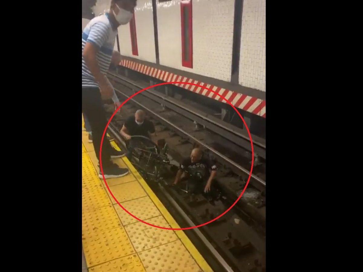 hombre silla ruedas metro