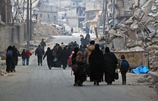 648x415_alep-syrie-12-decembre-2016-civils-fuient-quartier-soukkari-armee-bachar-al-assad-vient-reprendre-rebelles