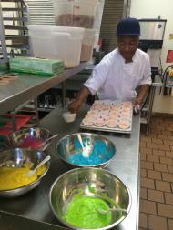 Lantern Community Services chef Otis bakes Pride-themed cupcakes