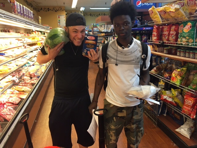 Two participants in Lantern's Food 4 Life youth nutrition program attend a shopping trip