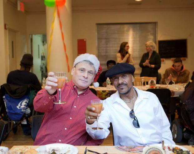Two Lantern residents toast the camera at a Thanksgiving dinner
