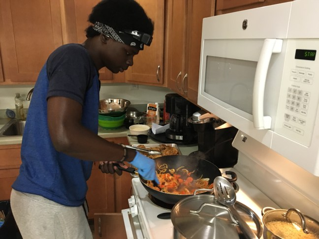 A Food 4 Life nutrition program participant cooks a stir fry dish