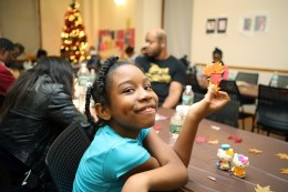 A child makes holiday decorations before a Thanksgiving meal at Lantern Community Services