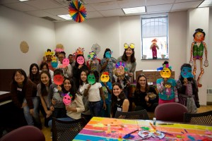 Lantern children and SVA students with the masks they made together