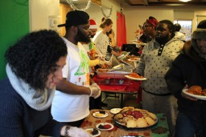 Lantern staff serve a holiday meal to young adults and families in the Bronx