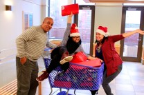 Lantern Community Services staff Leroy Thomas, Alyssa Negron and Jessica Rosado get ready to deliver gifts in the Bronx