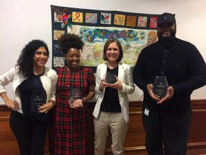 Cathy Batista, Sabine Mondesir, Laura Lazarus, and Roy Reid, with their staff achievement awards
