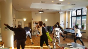 Residents participate in a zumba class for the launch of the FAB-YOU-ary fitness challenge
