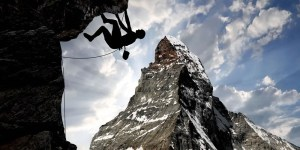 image of person climbing mountain
