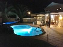 villa palmera pool by night
