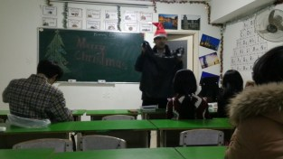 Giving out gifts to his students
