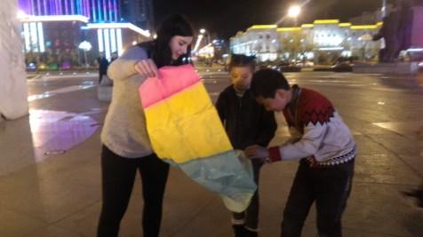 Little firework boy helped her prepare the lantern