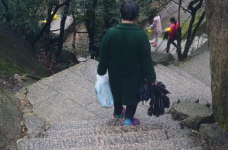 This crazy cat was hiking it what looks like SLIPPERS. I'm not even surprised.. it's China