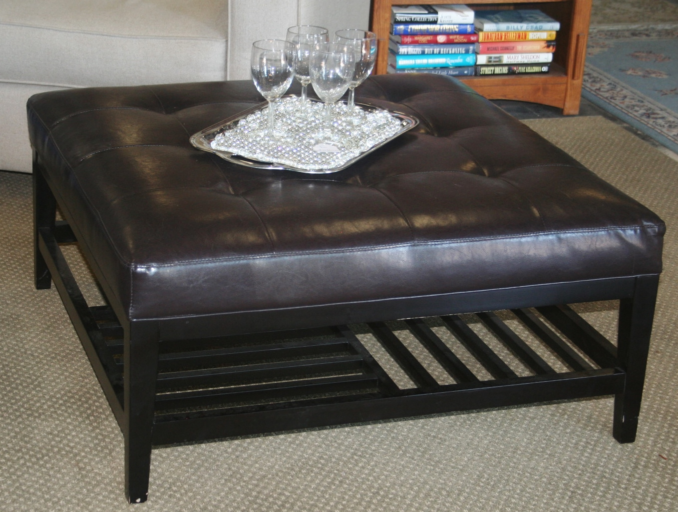black leather ottoman in new look