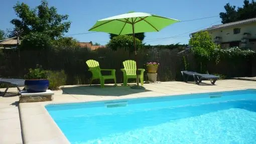 Seating area beside the pool. Essential information about your Vendée holiday
