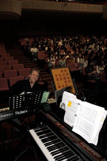 John Sawoski at the keyboard in Jinan, China.