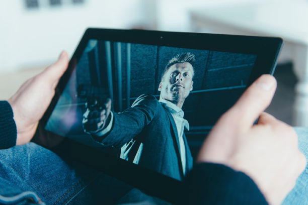 Watching a movie on a digital tablet