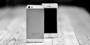 Image of 2 iPhone devices with a greyscaled background for mobile phone repair