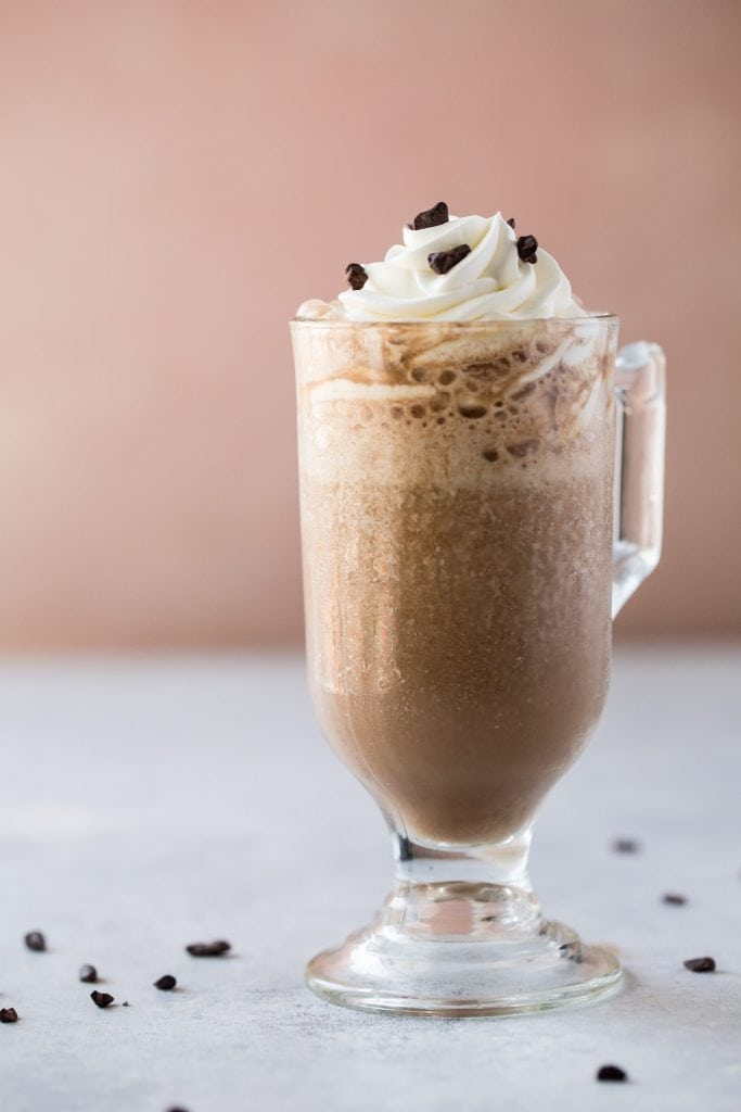 Image of a Java Chip Frappuccino in a small glass with a pink background