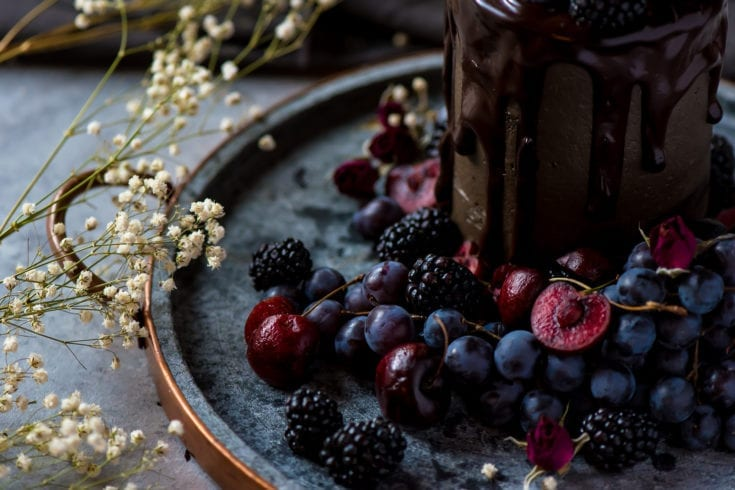 close up of a decadent cake with fruit