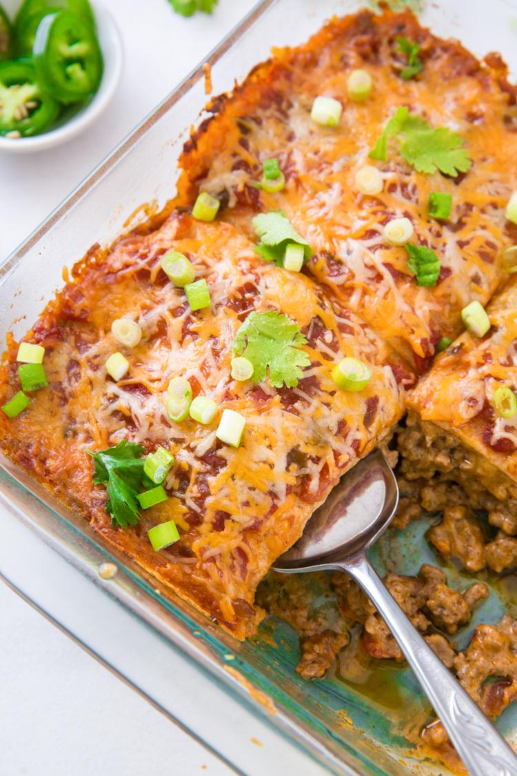 Keto Mexican Casserole in a glass dish with a spatula