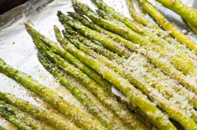 roasted garlic parmesan asparagus on a cookie sheet with aluminum foil