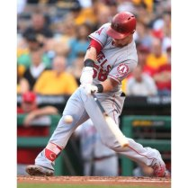 Jun 3, 2016; Pittsburgh, PA, USA; Los Angeles Angels right fielder Kole Calhoun (56) hits an RBI single against the Pittsburgh Pirates during the second inning at PNC Park. Mandatory Credit: Charles LeClaire-USA TODAY Sports