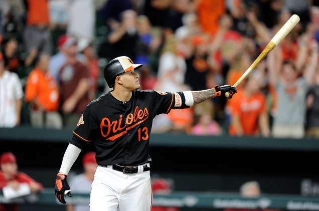 BALTIMORE, MD - AUGUST 18: Manny Machado #13 of the Baltimore Orioles hits the game winning grand slam in the ninth inning against the Los Angeles Angels at Oriole Park at Camden Yards on August 18, 2017 in Baltimore, Maryland. Baltimore won the game 9-7. (Photo by Greg Fiume/Getty Images)