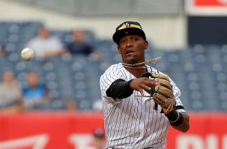 NEW YORK, NY - SEPTEMBER 20: Miguel Andujar #67 of the New York Yankees throws the ball in ninth inning against the Minnesota Twins on September 20, 2017 at Yankee Stadium in the Bronx borough of New York City. (Photo by Abbie Parr/Getty Images)