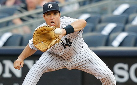 June 3, 2013; Bronx, NY, USA; New York Yankees first baseman Mark Teixeira (25) makes a catch for an out during the first inning against the Cleveland Indians at Yankee Stadium. Mandatory Credit: Anthony Gruppuso-USA TODAY Sports