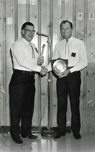 """Norman Merrbach congratulated Flippo for his first Gold Record Award for """"The Auctioneer."""""""