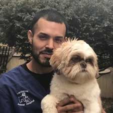 Larchmont team member Elvis, a veterinary assistant and kennel assistant