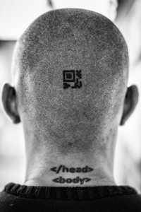"""Februrary 26, 2016. Bogotá, Colombia. Details of tattoos on the back of Ándres Sepúlveda (31) head, the top tattoo he calls it his """"Mayor Relic"""" it is a QR code encrypted in MAYA (he didn't want to revealed what is encrypted), the second tattoo: and he got while he was drunk. Ándres Sepúlveda lives at an undisclosed maximum-security building of the General Attorneys office (Fiscalia Nacional) in Bogotá, Colombia; where he is serving a 10 years sentence for hacking and spying on the government and elected officials. Photo Credit: Juan Arredondo for Bloomberg BusinessWeek."""