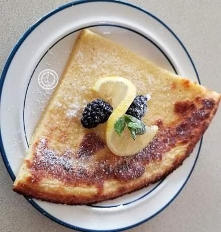 A slice of Dutch Pancake on a plate