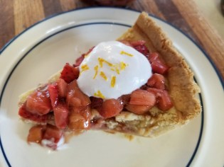 Strawberry Rhubarb Custard Pie with compote and whipped coconut cream