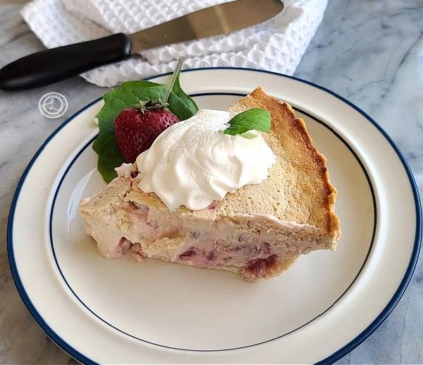 Strawberry Rhubarb Custard slice of pie on a white plate