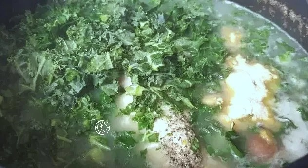 Keto Chicken Kale Soup adding in the kale