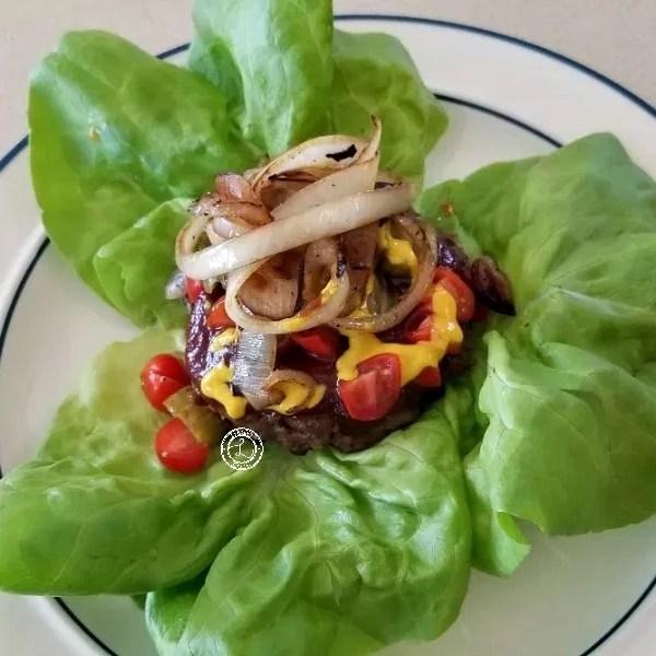 Prepared burger on Butterhead Lettuce