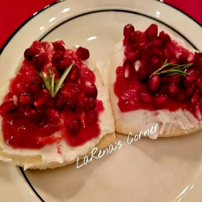 Cookies with frosting, jam, pomegranates and a little rosemary