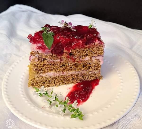 A piece Pumpkin Cranberry Tier Cake on a plate