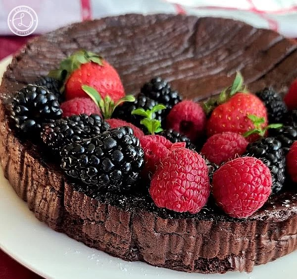 A partial picture of the Flourless Chocolate Cake with fresh fruit.