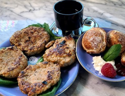 A picture of breakfast. Sausage, Danish pancakes, and espresso. Perfect for labor day