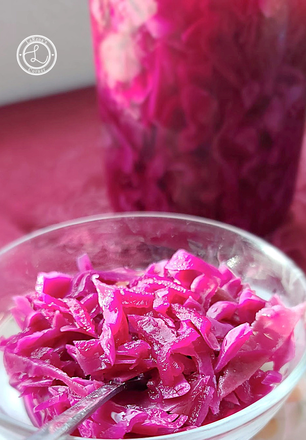 Sweet and Sour Red Cabbage in a quart jar in the background and some in a bowl in the front.