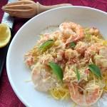A plate of Gluten-Free Creamy Seafood Alfredo with spaghetti squash for pasta. YUMMY