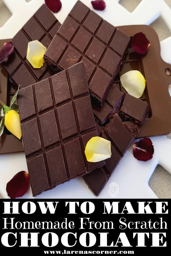Homemade Chocolate bars and a mold on top of a white plate decorated with rose petals
