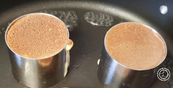 Water around the edges of the pan with 2 Gluten-Free Japanese Pancakes