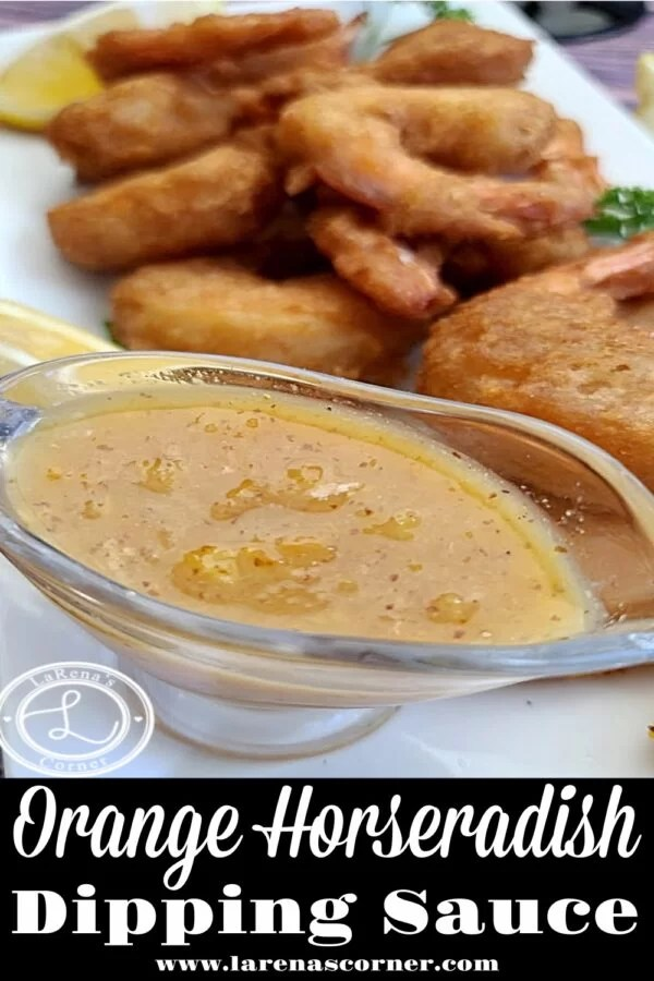 Orange Horseradish Dipping Sauce. Pictured is dipping sauce in front of a platter of coconut shrimp